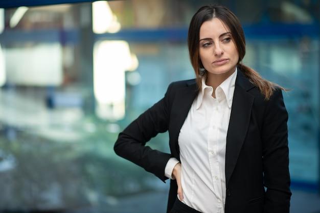 Confident businesswoman office interior portrait
