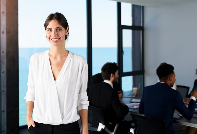 Confident businesswoman in office with his teamwork. concept of cooperation