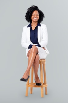 Confident businesswoman sitting on a wooden stool jobs and career campaign