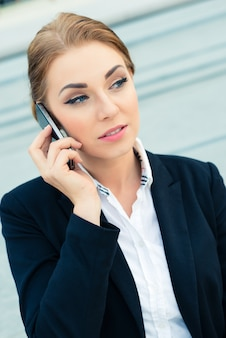 Confident businesswoman talking on business phone