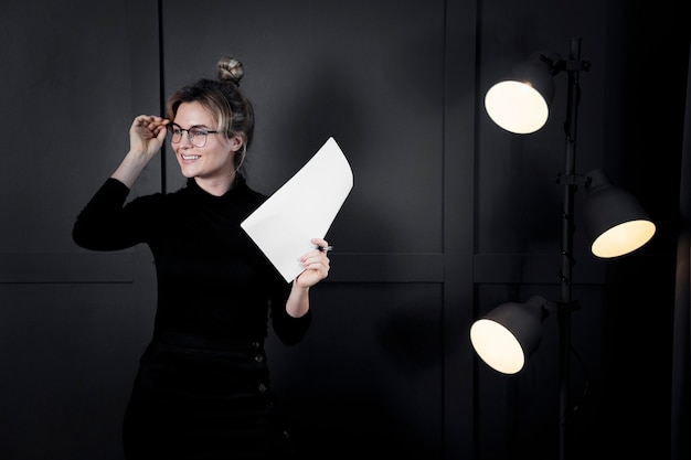 Confident businesswoman with eyeglasses looking away