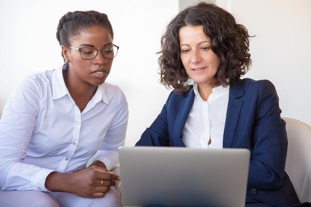 Confident businesswomen discussing project