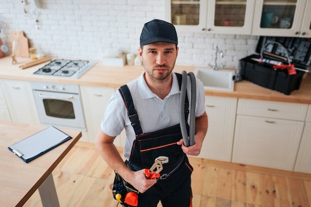 Confident calm young handyman look on camera