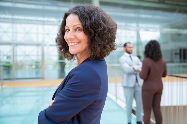 Confident cheerful businesswoman