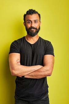 Confident concentrated arabic male posing isolated in studio, indian arabian modern man with deadpan expression