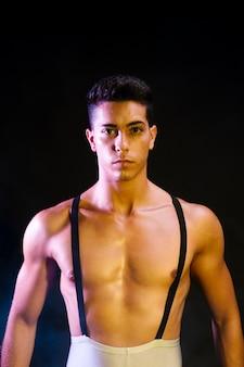 Confident contemporary dancer performing in spotlight