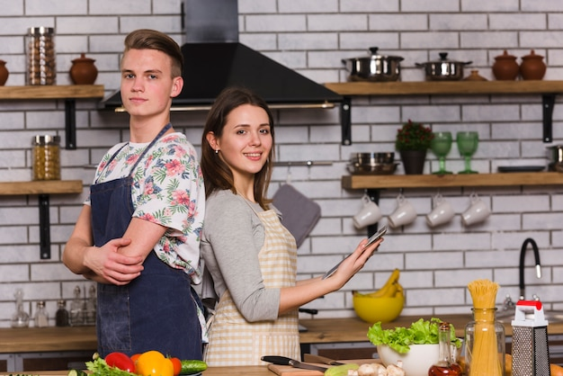 Confident couple standing in stylish kitchen