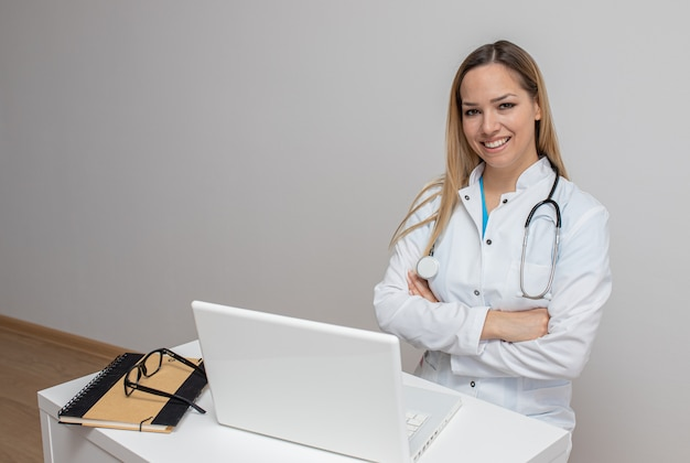 Confident doctor sitting arms crossed in office