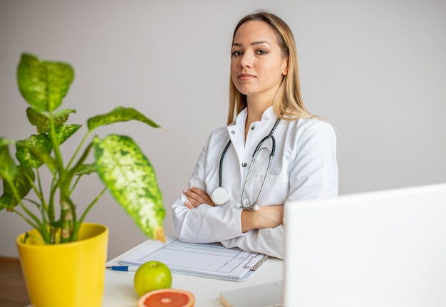 Confident doctor sitting in office