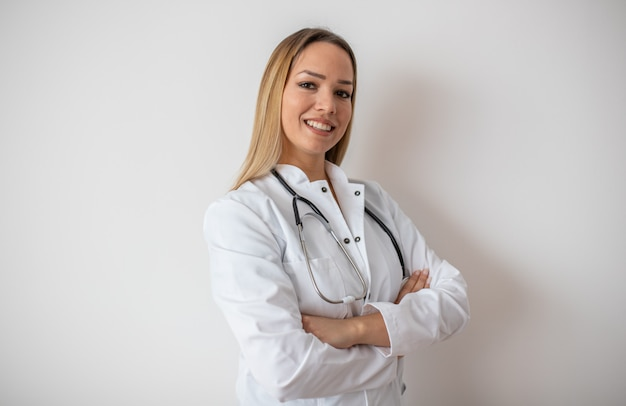 Confident doctor standing arms crossed