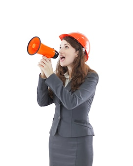 Confident female architect - engineer shouts into a megaphone a megaphone.photo with copy space
