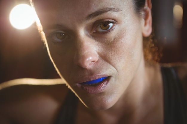 Confident female boxer closeup portrait