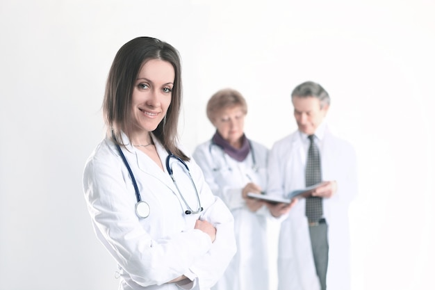 Confident female doctor therapist on blurred background of colleagues