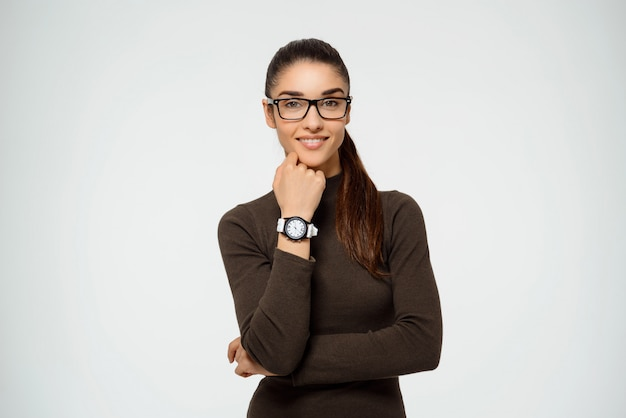 Confident female entrepreneur smiling