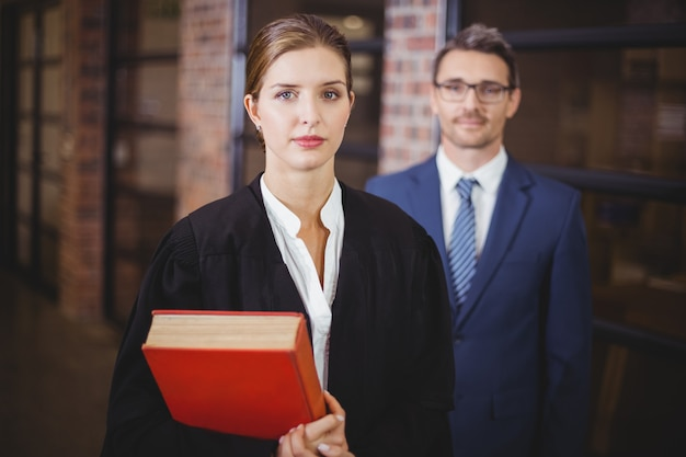Confident female lawyer with businessman in office