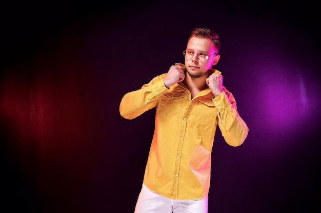 Confident guy adjusting shirt during party