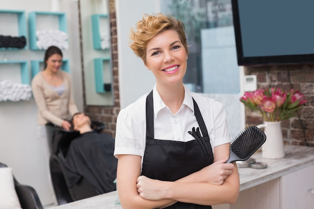 Confident hairdresser smiling at camera