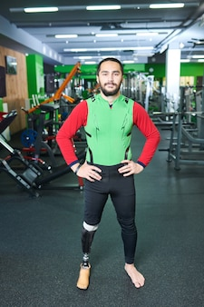 Confident handicapped man in gym