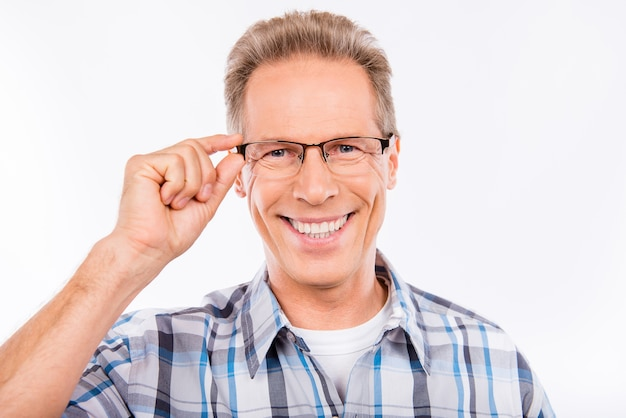 Confident happy aged man holding glasses