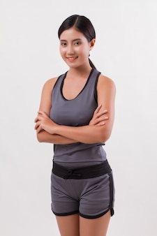 Confident happy smiling fitness woman isolated
