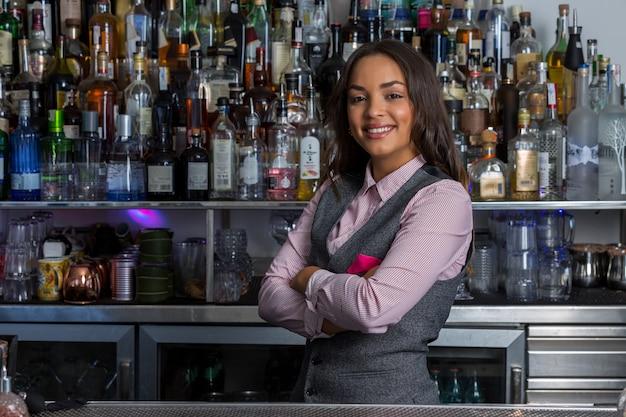 Confident hispanic woman working in bar