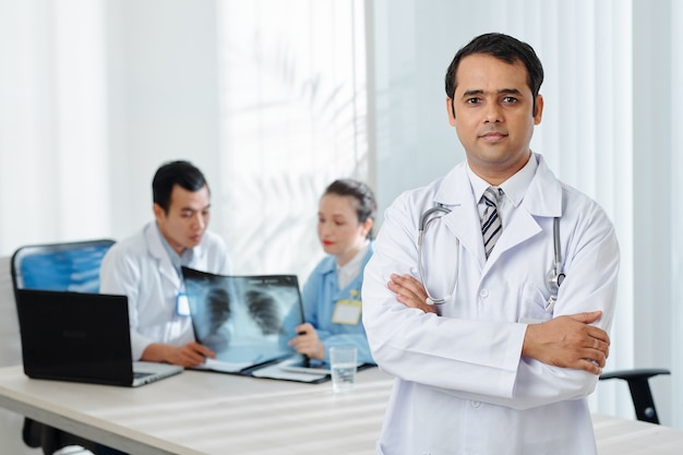 Confident indian physician