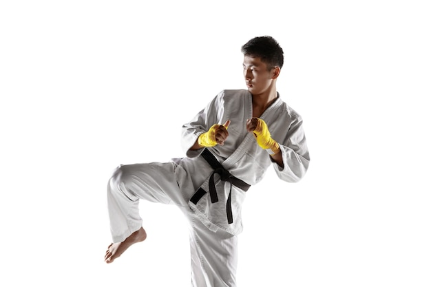 Confident korean man in kimono practicing handtohand combat martial arts