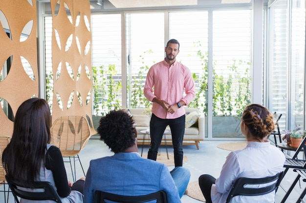 Confident male speaker holding seminar
