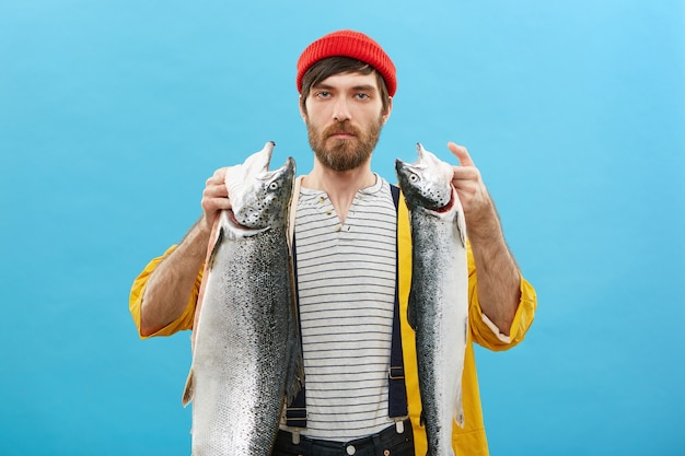 Confident man holding his big catch