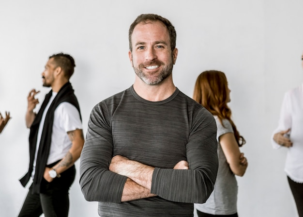Confident man standing in front of his talking team