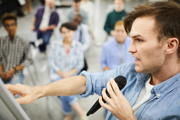 Confident man telling about powerful sales tools