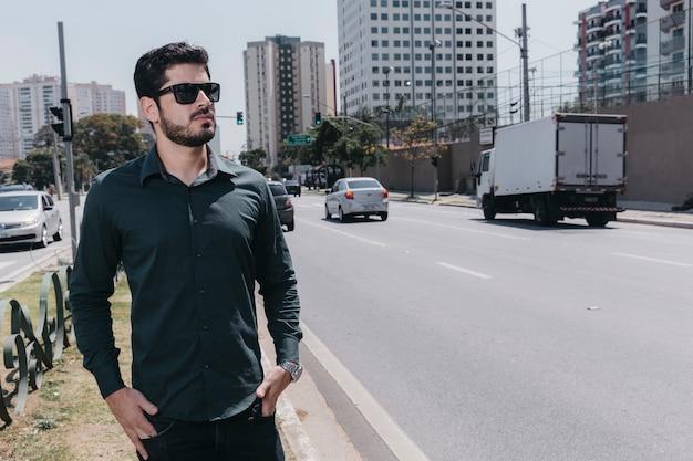 Confident man walking near road
