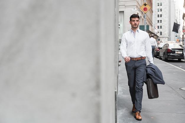 Free Photo | Confident man walking to work