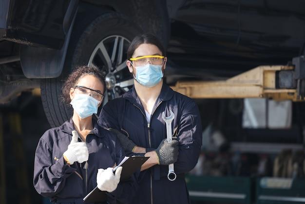 Confident mechanic standing at repair shop