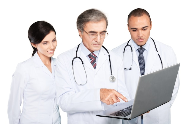 Confident medical team using laptop isolated on white
