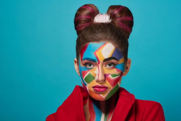 Confident model posing with pop art make up