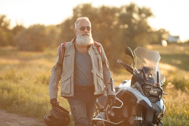 Confident old bearded biker man outdoor