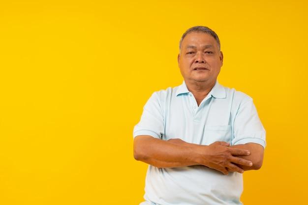 Confident old thai man fold arm