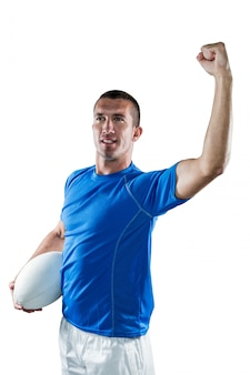 Confident rugby player flexing muscles