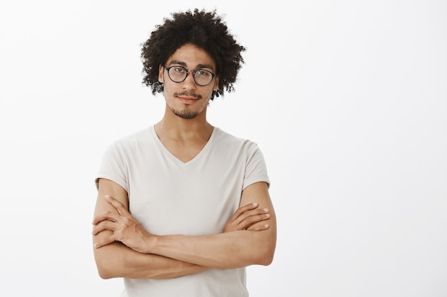 Confident smart man cross arms chest, wearing glasses, looking like professional