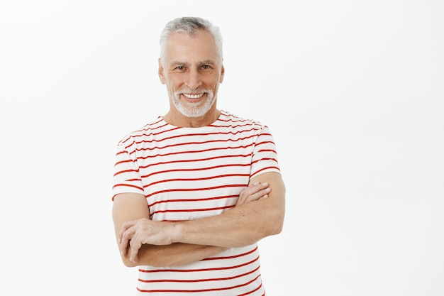 Confident smiling grandfather cross arms chest and looking happy