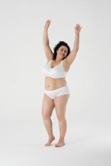 Confident woman standing in underwear