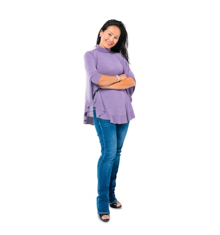 Confident woman standing with arms crossed