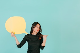 Confident woman with speech bubble pointing right