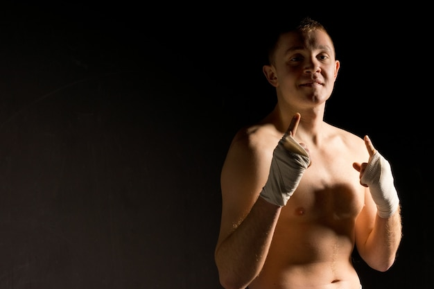 Over confident young boxer gesturing
