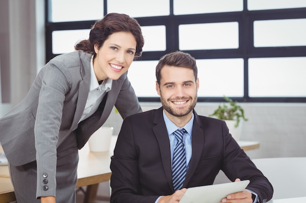 Confident young business people in office