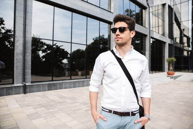 Confident young businessman dressed white shirt