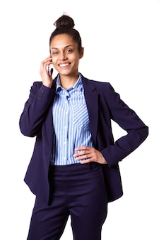 Confident young businesswoman talking on mobile phone