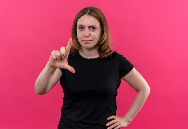 Confident young casual woman gesturing size with hand on waist on isolated pink space