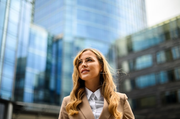 Confident young female manager outdoor in a modern urban setting. lots of copyspace
